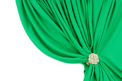 Green silk curtains with a clip Stock Images