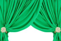 Green silk curtains with a clip Stock Photos