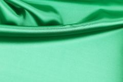 Green silk drapery. Royalty Free Stock Photo
