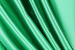 Green silk drapery. Stock Photos