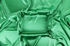 Green silk. Green sik background with some soft folds and highlights stock images