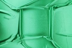 Green silk with soft folds. Royalty Free Stock Photography