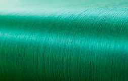 Green silk on a warping loom of a textile mill Stock Image