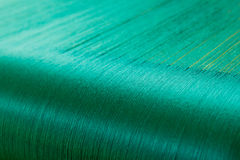Green silk on a warping loom of a textile mill Royalty Free Stock Photo