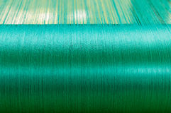 Green silk on a warping loom of a textile mill Stock Photography