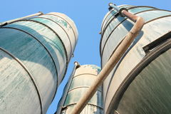 Green silos. Cement silos over a blue sky Stock Images