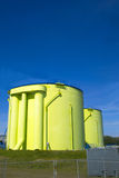 Green silos Stock Images