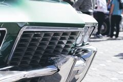 Green and Silver Car Grille in Tilt Shift Lens Royalty Free Stock Image