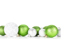 Green and silver christmas baubles Royalty Free Stock Image