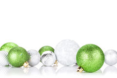 Green and silver christmas baubles. Isolated on white background Royalty Free Stock Photography