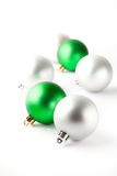 Green and silver Christmas baubles on white Stock Photos