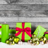 Green and Silver Christmas Items on Wooden Wall stock photo