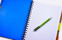 Green and Silver Push Pen on White Ruled Paper Indoors Stock Images
