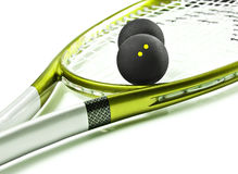 Green and silver squash racket and balls Stock Images