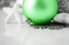Green and silver xmas decoration on white backgrou Royalty Free Stock Photo