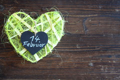 Green sisal heart on wood Royalty Free Stock Photos