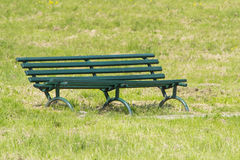Green sitting bank in park Royalty Free Stock Photos