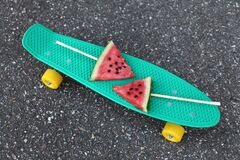 Free Green Skateboard With Watermelon Popsicle Ice Cream On The Stick On An Asphalt Background, Top View Royalty Free Stock Images - 216680929