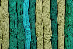 Green skeins of floss as background texture Stock Photography