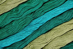 Green skeins of floss as background texture Royalty Free Stock Image