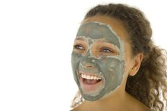 Green skin care mask. Young happy woman with green purifying mask. She's on white background Royalty Free Stock Images