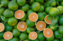 Green skinned lemons with orange pulp Royalty Free Stock Image