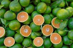Green skinned lemons with orange pulp Royalty Free Stock Image
