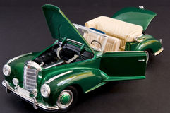 Green sleek classic luxury car. Picture of a geen beautiful classic luxury car Stock Image