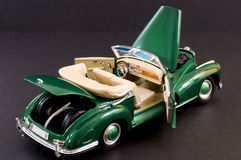 Green sleek classic luxury car. Picture of a green beautiful classic luxury car Stock Photography