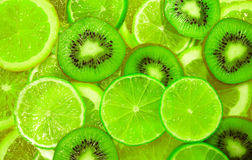 Green slice of lime and kiwi background Stock Images