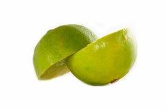 Green Sliced Lime. Bright green sliced lime over white background Stock Image