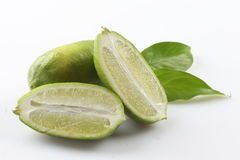 Green sliced lime on white background with herbs. Deliciously Royalty Free Stock Image