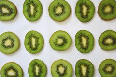 Green slices of Kiwi fruit on white background. Slices green kiwi fruit white background closeup pattern dessert  diet fresh freshness healthy juicy nature royalty free stock photo
