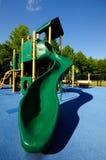 Green slide, blue ground Stock Photo