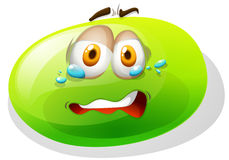 Green slime with scared face Stock Photography