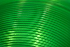 Green Slinky. A macro look at the inside of a green plastic Slinky stock images