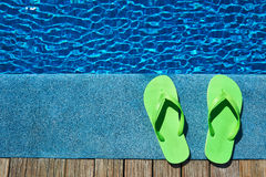 Slippers by a swimming pool Royalty Free Stock Photography