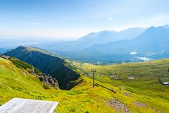 The green slope of the mountain Kasprowy Wierch with ski lift in Stock Photos