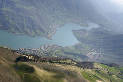 Green slopes over Endine lake, Orobie Stock Photo