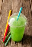 Green Slushie Drink in Plastic Cup with Straws Royalty Free Stock Image