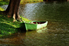 Green Small Boat Stock Photos
