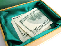 Green small box with one hundred dollar bill sticking Stock Image