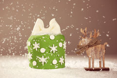 Green small cake with snow Stock Photos