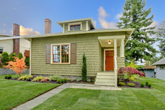 Green small craftsman style renovated house. Stock Photography