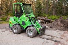 Green small forklift Avant 635. Imatra, Finland - June 11, 2015: Green small forklift Avant 635 stands on a logging area stock image