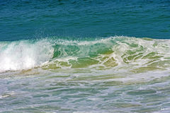 Green, small and transparent wave Stock Photo