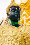 Green smaragd golden buddha statue in Wat Phrathat temple Royalty Free Stock Photography