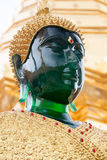 Green smaragd golden buddha statue in Wat Phrathat temple on Doi Stock Photography