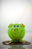 Green smiling piggy bank Royalty Free Stock Image
