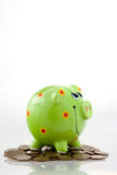 Green smiling piggy bank Royalty Free Stock Images